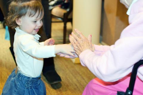 "The Vernon Area Public Library's ""Oaks and Acorns"" storytime brings children 4 and younger together with residents of Sunrise Senior Living in Buffalo Grove."