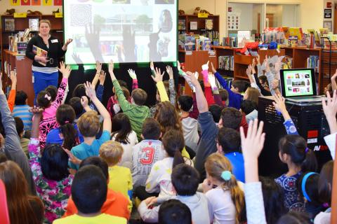 Vernon Area librarian Maggie Kutsunis explains the Dewey decimal system to fourth-graders at Tripp School in Buffalo Grove, Illinois.