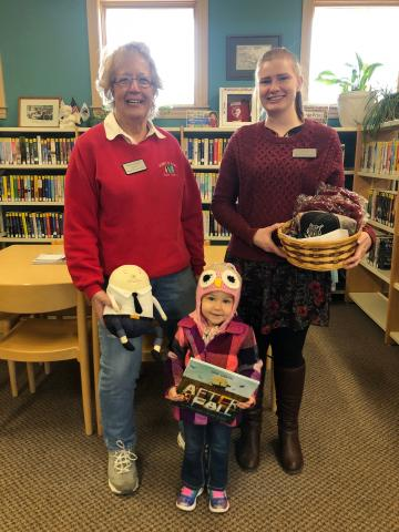 Library staff with happy young patron.
