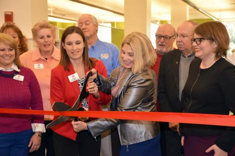 Schaumburg Library officials, local mayors and patrons celebrate the remodeled first floor with a ribbon cutting ceremony.