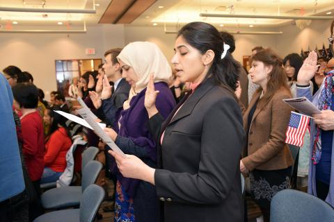 Citizens-to-be recite the U.S. Naturalization Oath at the Schaumburg Library.
