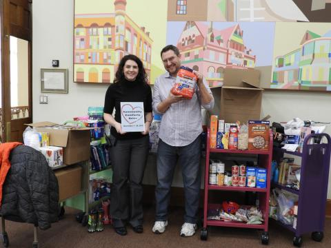 Rock Island Reference Librarian Karrah Kuykendall and Christian Care Community Outreach Coordinator Steve Gottcent show the results of the Community Comforts drive.