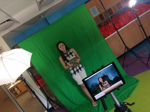 Student patron filming her book review from summer reading programs
