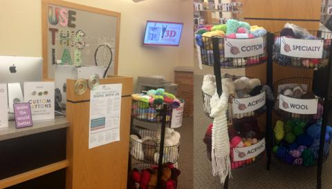 Photo shows the yarn swap baskets near the Digital Media Lab desk, separated into Specialty, Acrylic, Wool, and Cotton yarn