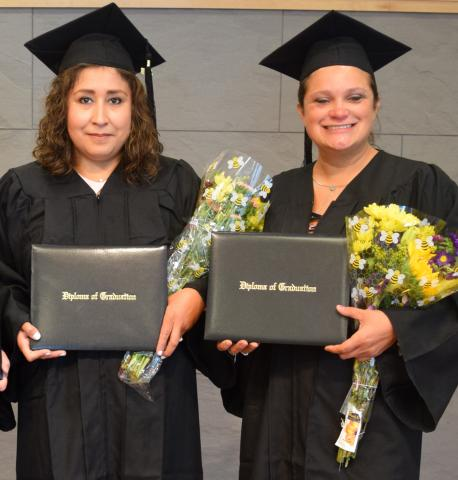 Pictured (left to right) Addison residents Irma Tena and April Camire celebrate their graduation at the Addison Public Library.