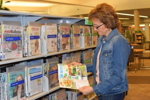 Lori Hartnett browses food and health magazines at the Vernon Area Public Library. She took classes at the library to help her launch a new business.