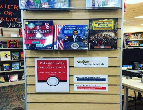 a slatwall display of children's materials about elections