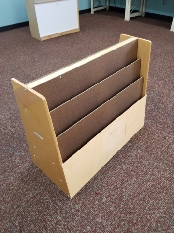 Wooden Free Standing Shelving Used To Store Oversized Picture Books.