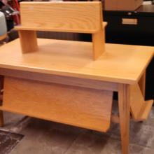 Two display tables, one is oak, the other is maple