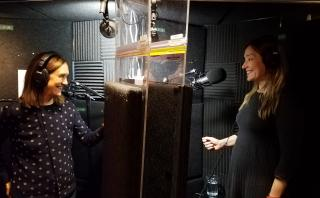 Deirdre Brennan and Kim Caviness in a recording booth